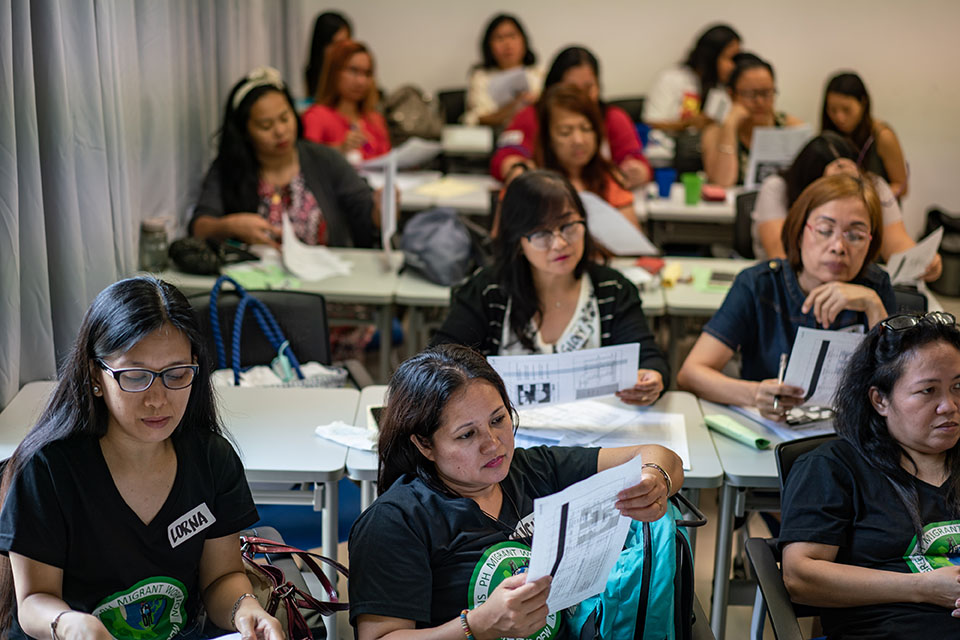 A workshop hosted by IDWF teaches domestic workers about their employment status in Macao