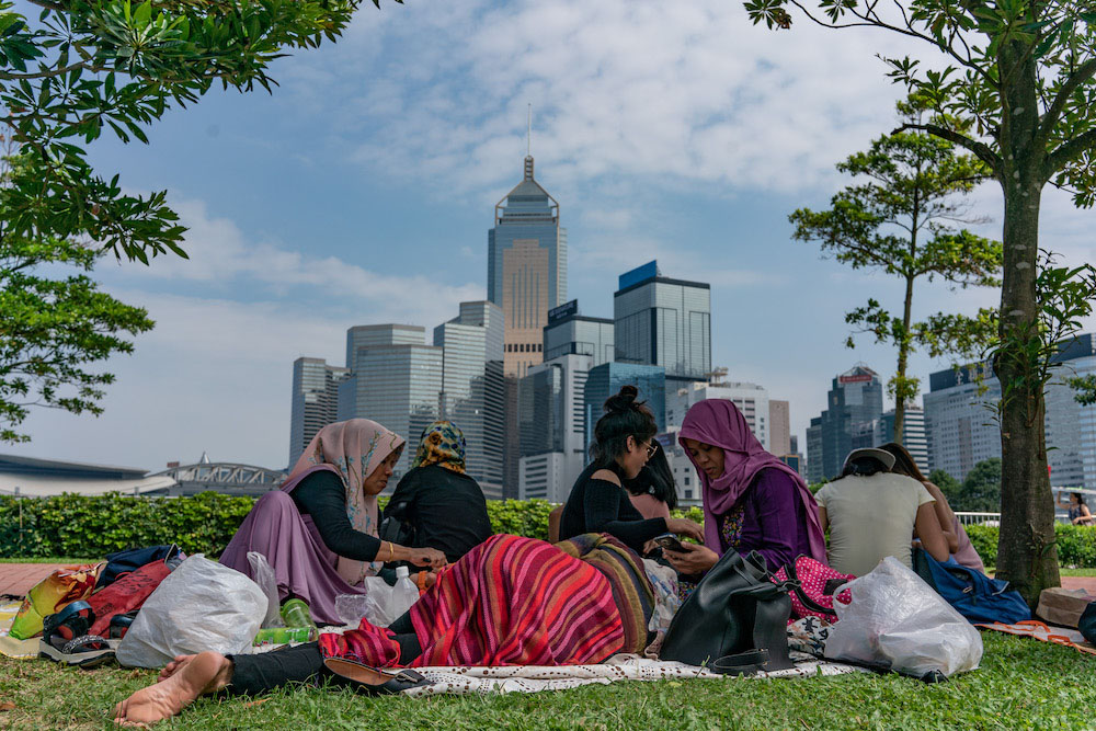 Domestic workers enjoy their day off in Hong Kong