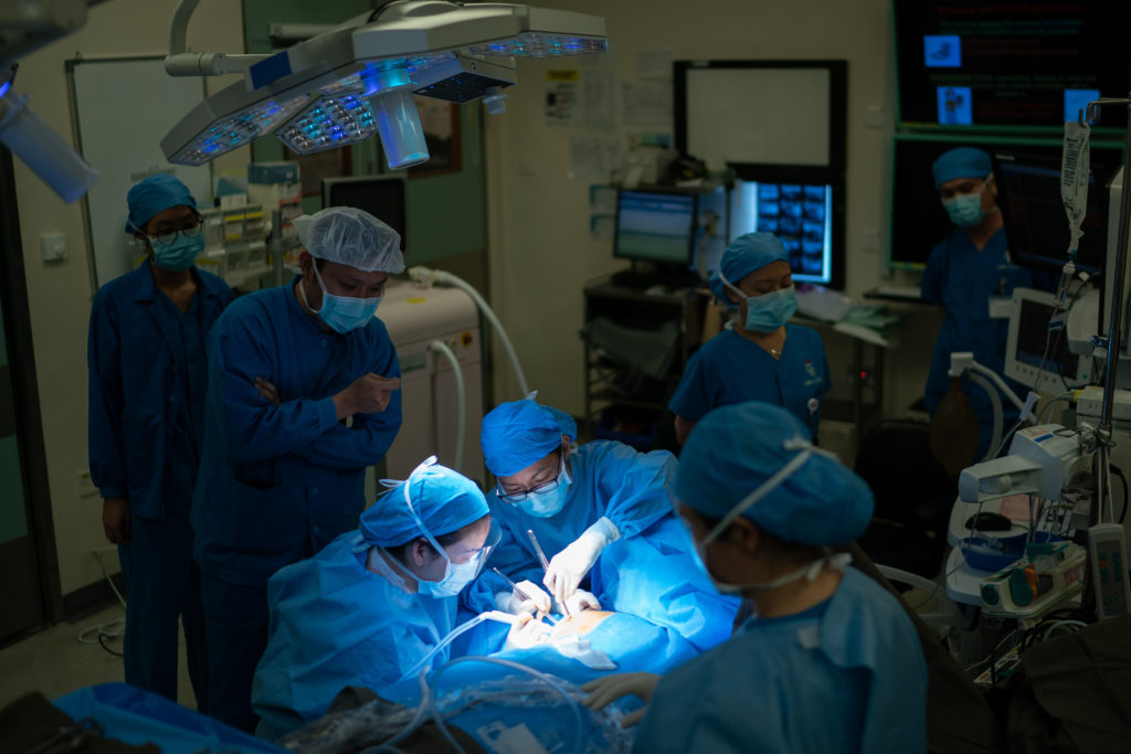 Doctors performing a mastectomy