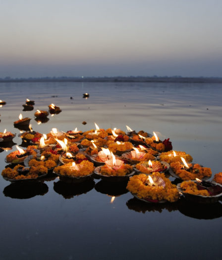 Religious Offerings And Oil Lamps Floating On Water, Ganges River, Varanasi, Uttar Pradesh, India