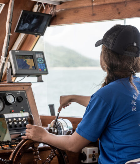 Sarah Yip Takes The Helm Of Her Boat. May 5, 2020.